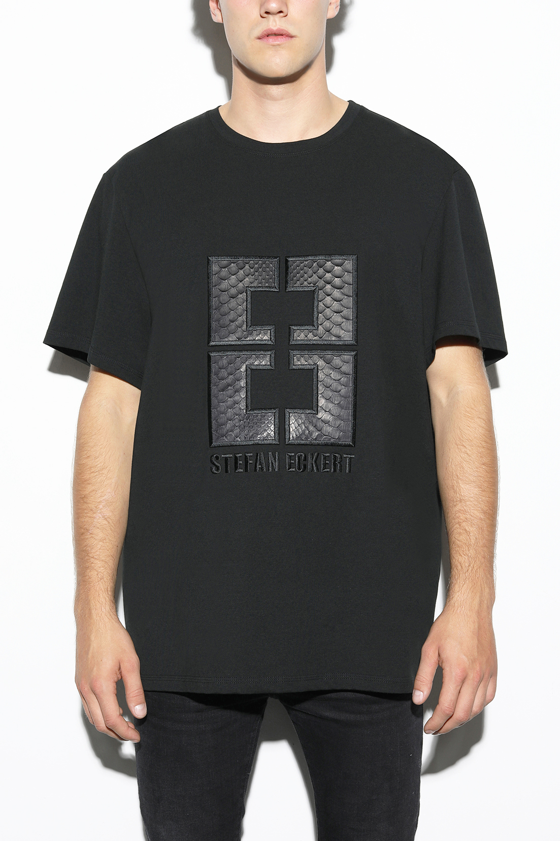 Logo T-Shirt for women and men by designer Stefan Eckert with embroidery of black python leather, made of organic cotton, sustainably produced in Germany