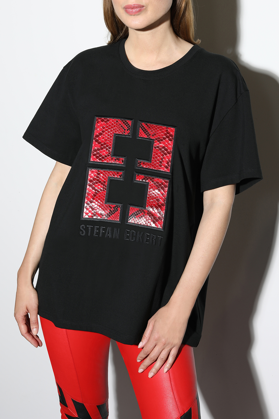 T-shirt-with-logo-embroidery-in-red-python-leather,-sustainably-made-from-organic-cotton,-by-designer-Stefan-Eckert